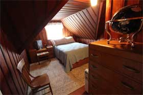 The Captain's House - Wood paneled bedroom